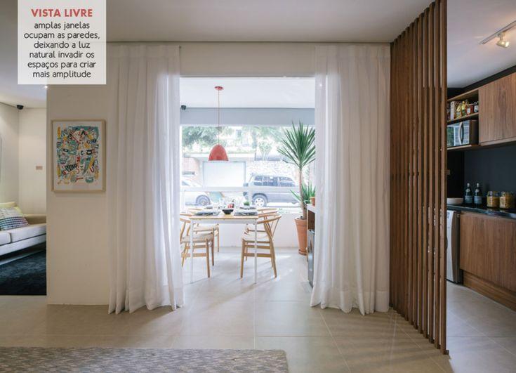 varanda e sala integrada separadas apenas pela cortina