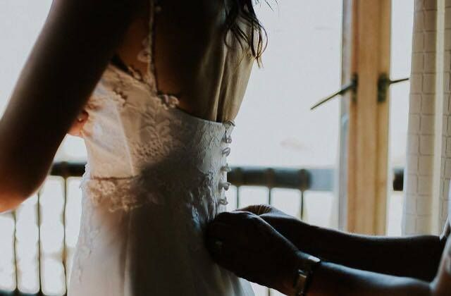 Guipure lace leaves hand-stitched around the bodice and straps, and delicate pearl buttons finished off Lezaan's low back beautifully.