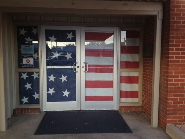 The doors at the main entrance of our building decorated for Veterans Day.