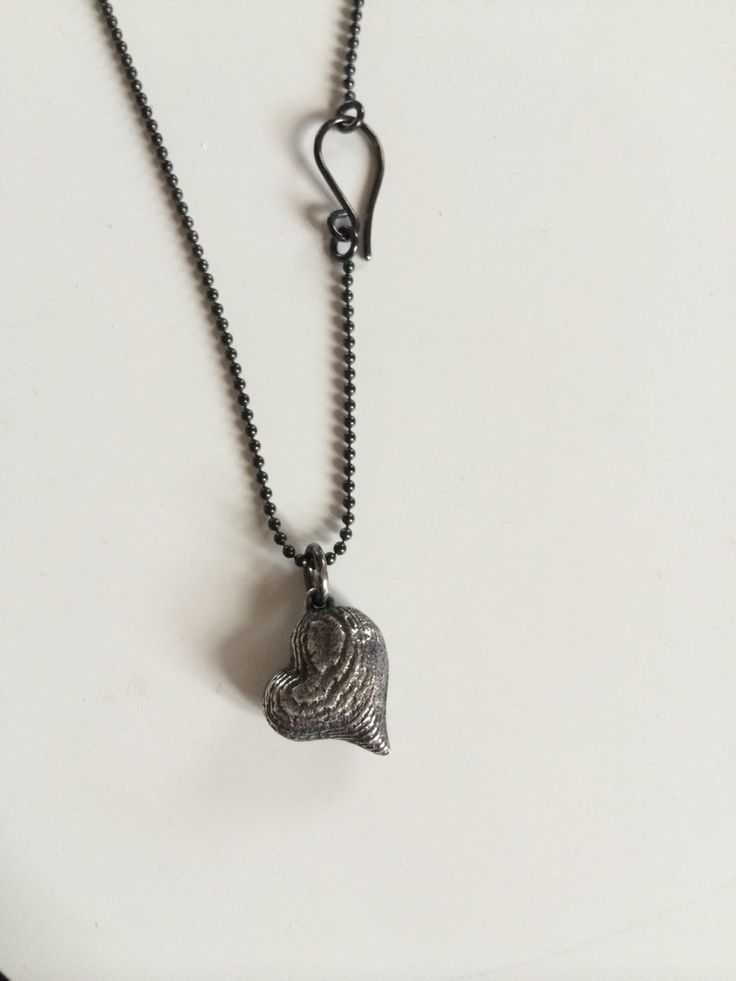 Oxidised silver heart cast in sepia shell