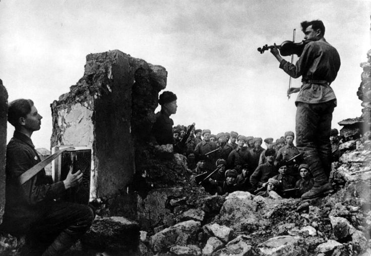 bag-of-dirt:Soviet soldiers play a nocturne for their comrades amidst the ruins of battle. Novoshahtinsk, Rostov Oblast, Russia, Soviet Union. Autumn 1942. Photograph by Yakov Khalip.