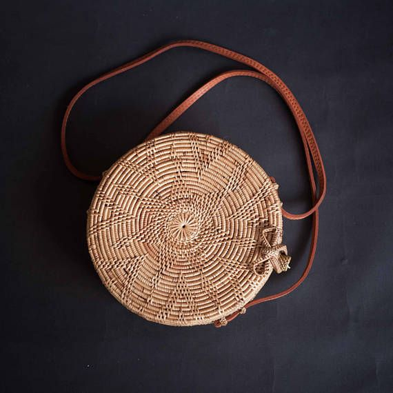 Ata Rattan Round Shoulder Bag natural leather and Unique Ata Clip and Unique Star Pattern Ata is a family of Rattan Tree, Its a little bit smaller than Regular Rattan. Its growing in the Tropical jungle in South East Asia Here in Bali, Usually We use it to create a Fish Trap . Each product will take approximately a week to create, And all product need to go into oven, to make it more stronger and remove all the insects. Thats why we got a beautiful Dark Brown color. Measurements, Diameter...