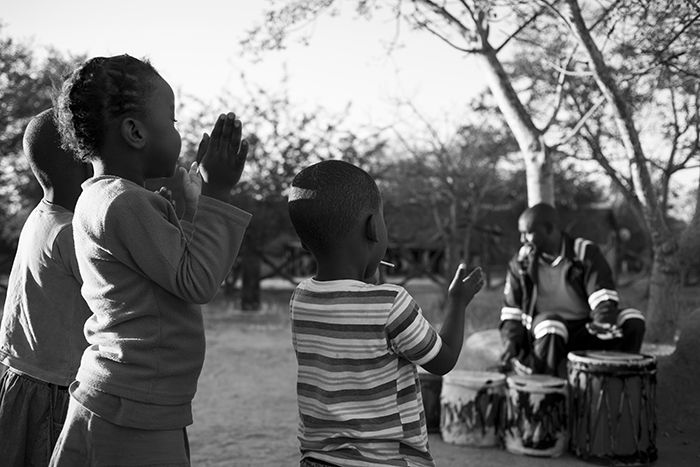 Some of our Londolozi children enjoy the Mshongolo during practise for their upcoming performances. Photograph by Caitlin Fay Smith