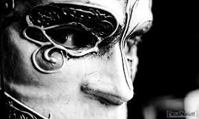 Image result for carnival mask:  I love how unyieldingly stiff and porcelain-cold this mask is, and how alive and liquid the eye is in contrast.