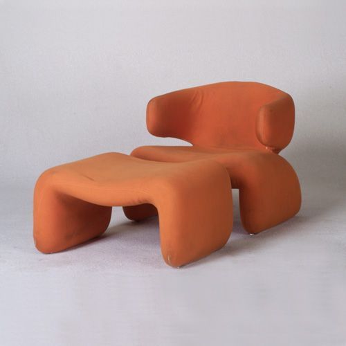 OLIVIER MOURGUE `Djinn` Lounge Chair And Ottoman Covered In Burnt Orange  Stretch Jersey Fabric.