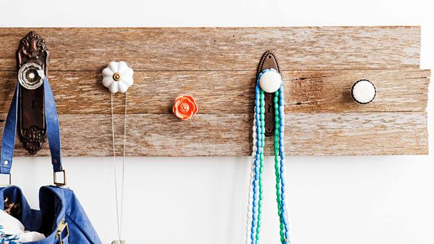 Creative Coatrack (DIY)  Even with a small budget one can create a cool coatrack using found wood and a selection of decorative knobs.  Get the DIY from Real Living (Photography Chris Warnes).