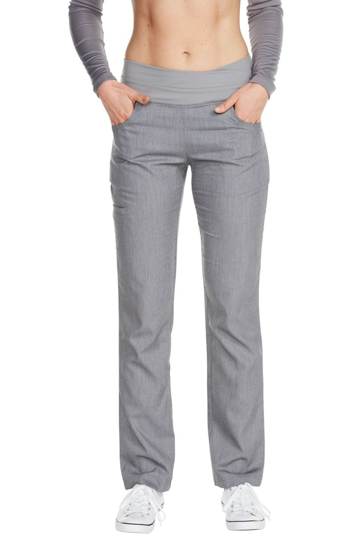 "The ""Cross My Hip"" scrub slack is a stylish pant that blurs the lines between workwear and performance wear. Structured to keep up with your physically demanding lifestyle, this pant is both functional and flexible. Our stretch shape enhancing fabric offers the comfort of your favorite athletic pant with the tailored drape of a slack.Fabric: Stretchy woven Polyester/Rayon/SpandexSignature 4"" compression waistbandShape enhancing front and rear pocketsSide welt pocket for maximum…"