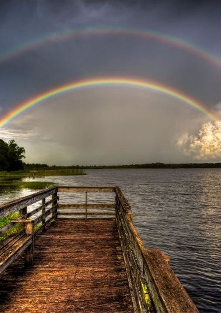 A nice double rainbow over Red Beach Lake in Sebring, Florida