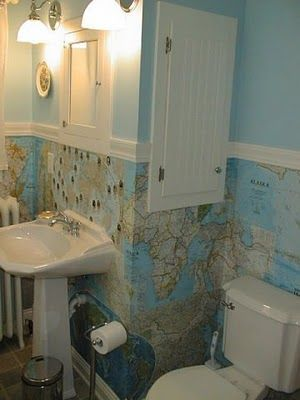 I have always wanted a bathroom wallpapered with maps.  Looks like someone beat me to it!