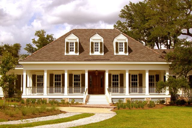 Hip roof wrap around porch style is acadian creole for Acadian style house plans with wrap around porch