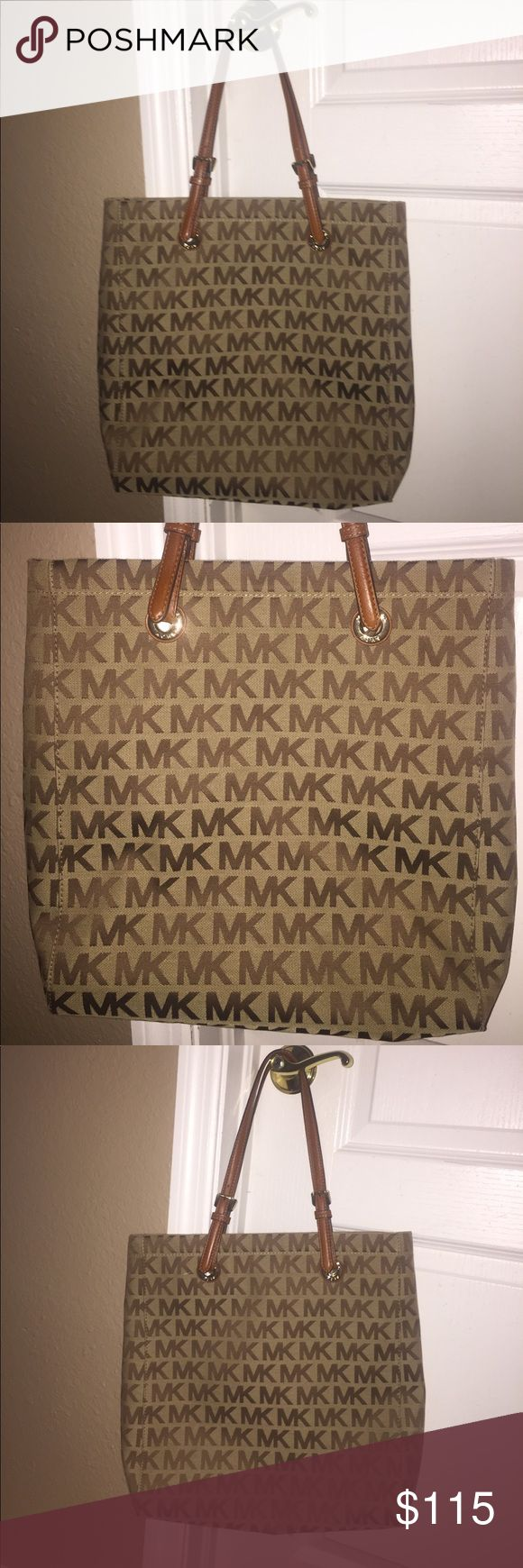 Spacious never used Michael Kors tote bag Would be great for travel or school bag. Make an offer, up for negotiation. Comes from a smoke and pet free home. Michael Kors Bags Totes