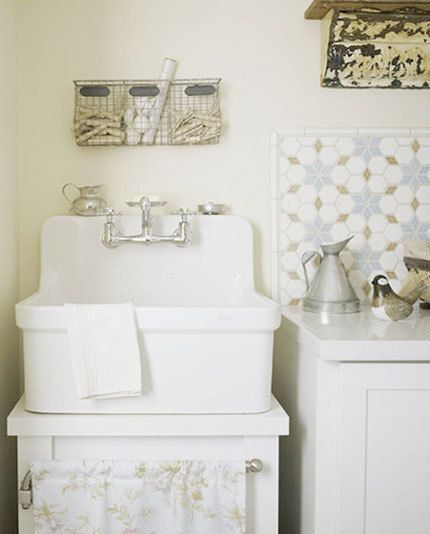 Cute laundry. Love the farmhouse sink with the skirt below and love the wire basket above for clothes pins, etc.