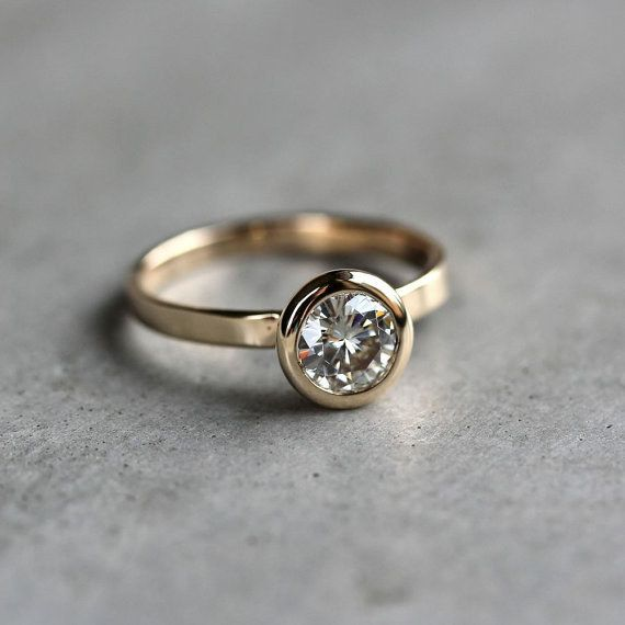 This sparkling 14k gold moissanite ring: | 32 Insanely Sparkly Non-Diamond Engagement Rings You Can Actually Afford