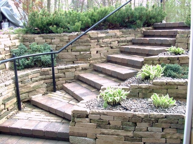 95 best images about walkout basement on pinterest fire for Stone retaining wall ideas