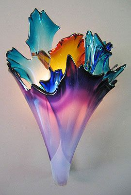 Hand blown glass wall sconce. Beautiful functional art.  Looks like the northern lights