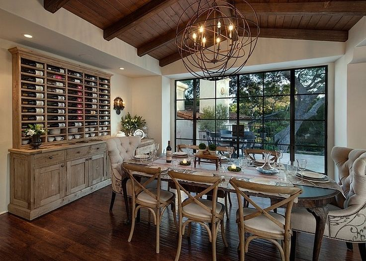 An Extravagant Dining Room With Luxurious Wooden Dining Table And Chairs  With Glass Table Decors And