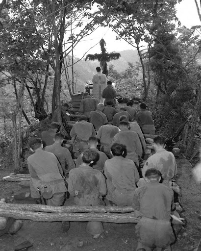 Fr. Kenny Lynch offering Mass during the Korean War.  What they had to sacrifice....