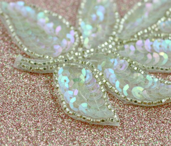 Beautiful leaf-shaped applique of shimmering iridescent sequins and silver beading.  Fabulous for wedding/bridal, head pieces, sashes, cake decor, etc..  Available in several colors...