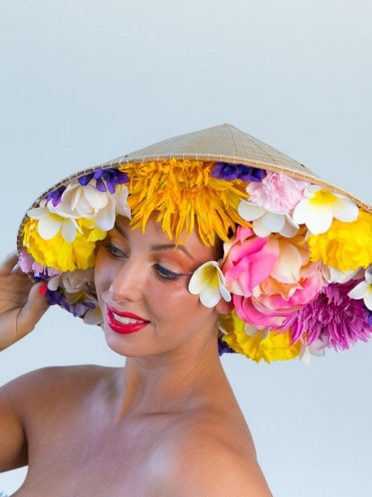 FLOWER DRUM | Floral Hat for Spring Racing Carnival | FORD MILLINERY  $595  From the back, people may wonder why you wore a basic oriental sunhat? But the moment you turn around, a stunning bouquet of colour knocks all to the ground. Flower Drum is truly an amazing little secret, that makes any face hidden within, shine. Like any hand-arranged bouquet, each headpiece will be slightly different to the next. An array of silk flowers of pink, white, purple and yellow, housed in a natural bamboo…