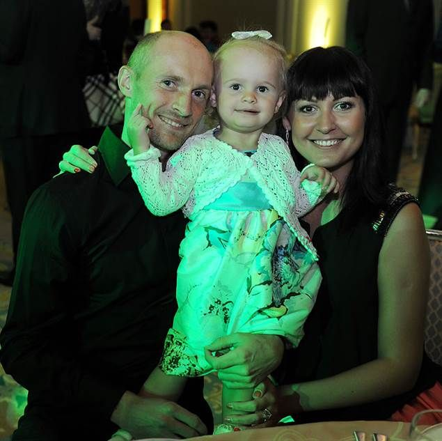 ATP Players Attend 2014 Doha Player Party- Adorable family photo of Nikolay Davydenko and his wife and daughter.