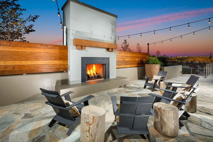 Trumark announces opening of community Kindred House at Wallis Ranch in Dublin, CA. Kindred House out.door fireplace. Credit: Christopher Mayer Photography
