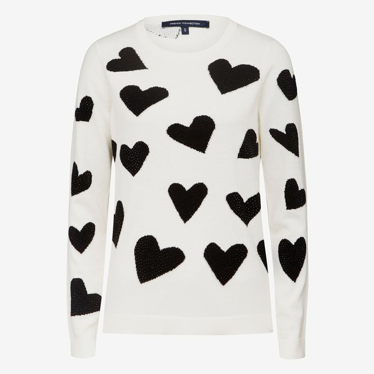 Just in time for Valentine's Day. The Be My Valentine Knit is a classic slim fit and cropped in length, featuring intarsia hearts and rhinestone studs, it's a simple way to add fun and novelty to your outfit. 50% WOOL/50% COTTON, Cold Hand Wash
