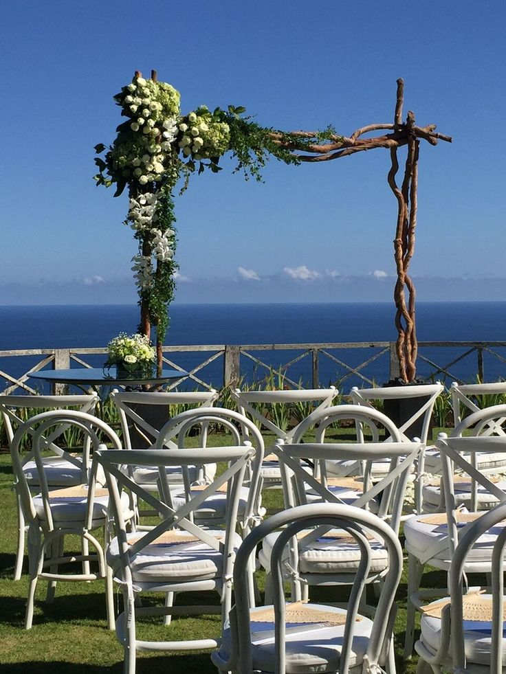 Rustic Ceremony Arbor with a breathtaking cliff-top backdrop - THIS is why you get married in Bali!  .  .  .  Wedding Inspo / Beach Wedding / Bali Wedding / Wedding Ceremony