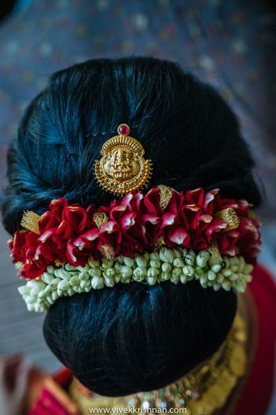 South Indian Hairstyle - Floral Bun with a Temple Jewelry inspired Bun Pin | WedMeGood Photo by: Vivek Krishnan photography #wedmegood #indianbride #indianwedding #bridalbun #hairstyle #bunpin #templejewelry