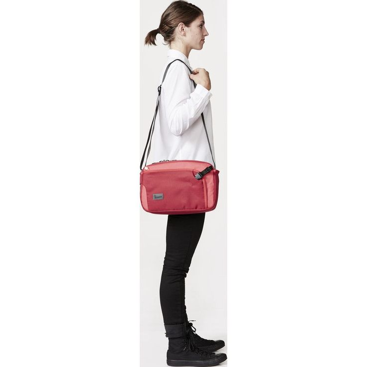 Crumpler Dry Red No 2 Shoulder Bag | Red DR2002-R00G40 Keep your travel documents and personal belongings close to you in the Crumpler Dry Red No 2 Shoulder Bag. This water resistant bag is big enough for all of your in-flight distractions yet small enough to slip under the seat without stealing legroom.