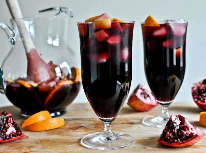 Pomegranate Vanilla Sangria: Navel Orange, Apple, Pear, Pomegranate Arils, Cinnamon Sticks, Vanilla Beans, Red Wine, Sparkling Pomegranate Soda, Brandy, Sugar, Vanilla Extract