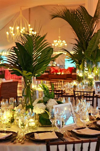 Palms for centerpieces, love the height & not as costly as flowers .. Perfect for the beach wedding!