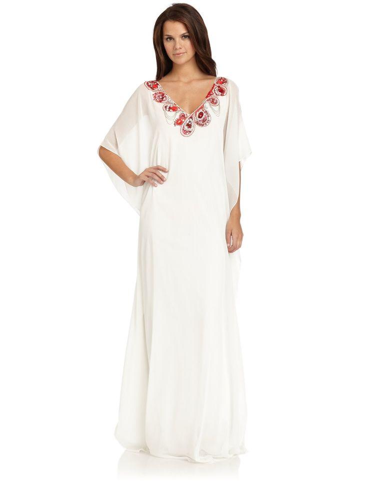 long caftan  noun  a woman's long loose dress.       TORY BURCH   Pink Catarina Caftan Cover Up Maxi Dress   A Tory Burch cover-up maxi dr...
