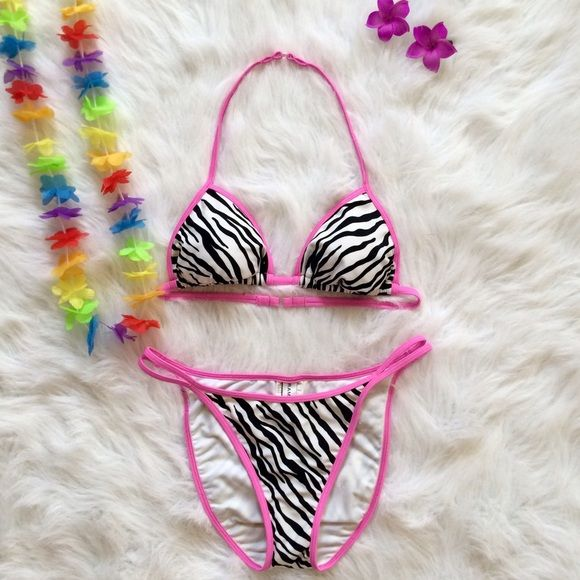"""Rampage Zebra Bikini Unleash your wild diva side with this cute zebra print bikini featuring hot pink piping from Rampage! Double pink piping on the hips will show an extra peekaboo of skin!  Soft, lightly padded cups will keep your """"chilly moments"""" camouflaged! Top is Medium & Bottoms are Large. Hygienic liner attached. Rampage Swim Bikinis"""