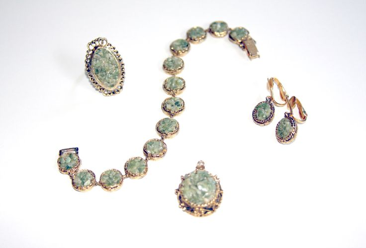 SALE 30%OFF ELEGANT Vintage Green Jade Stone Jewellery Jewelry Set Pendant Bracelet Ring Clip-on Earrings Gold Tone Jade Chips 1970s 70s by prismaticvintageshop on Etsy https://www.etsy.com/listing/186462138/sale-30off-elegant-vintage-green-jade
