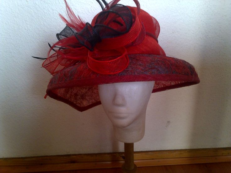 Sinamay hats designed and custom made by Franchelle Hats. www.franchelle.co.za
