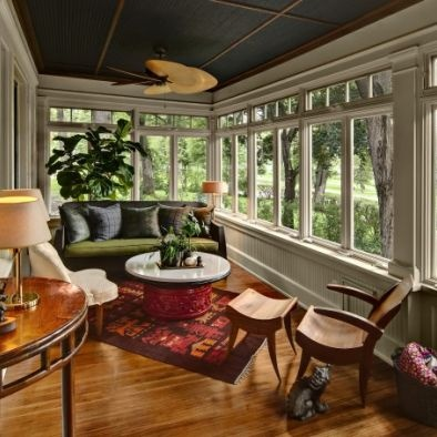 Eclectic Enclosed Sunroom/Patio - window style with undivided bottom casements topped with divided transoms. Love!