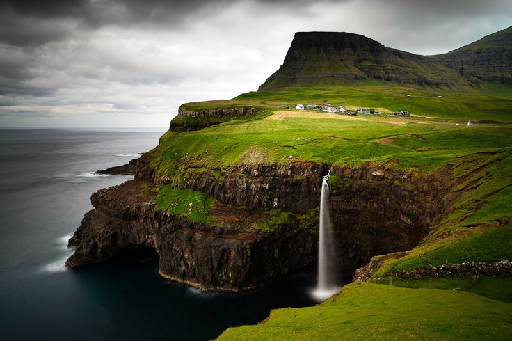 Gásadalur Village in the Faroe Islands has a population of 17 people. The Faroe Islands are under the sovereignty of the Kingdom of Denmark, situated between the Norwegian Sea and the North Atlantic Ocean, approximately halfway between Norway and Iceland.