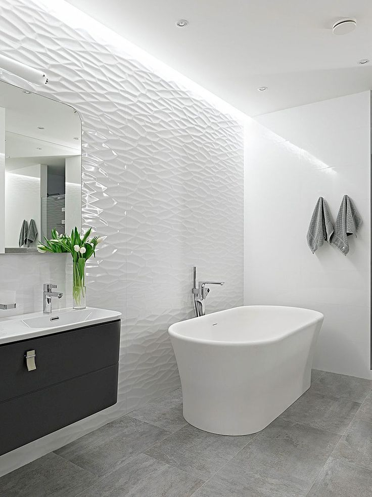 The 25 best grey bathroom tiles ideas on pinterest grey for Salle de bain blanche moderne