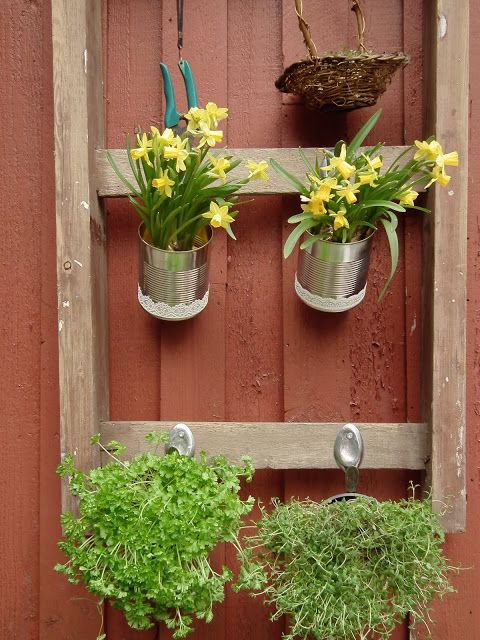 Bless: Reusing an old ladder and recycling tin cans