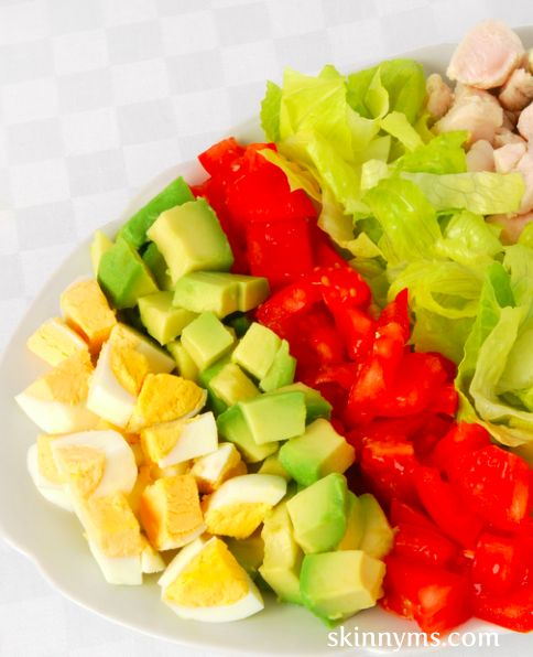 This Clean-Eating Cobb Salad is a lighter version of the traditional, but it is oh-so delicious. It uses light olive oil dressing, chicken, and eggs. #cleaneating #salads