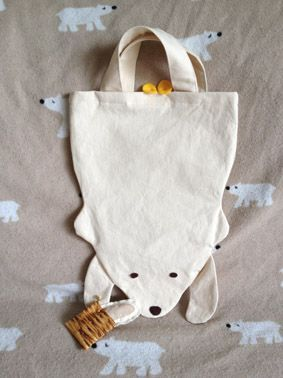 could upcycle a boring old tote bag into this adorable bear bag.  Seriously... How cute is this??