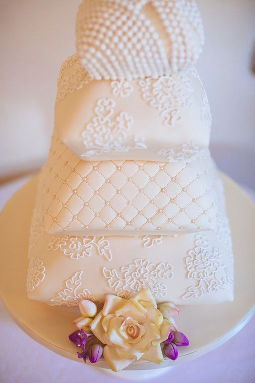 My lovely wedding cake. Pillow cakes designed with the lace of my wedding dress. White icing simple, classic with a twist.