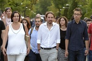 Handsome fellow - Leader of Podemos political party Pablo Iglesias (C), with Podemos' members Inigo Errejon (R) and Carolina Descansa (L) walk during a demonstration called by associations, unions and left-wing politicians in support of Greece, in Madrid on June 27, 2015. The European Central Bank said today its governing council would meet imminently as Greece appears increasingly to be heading towards a default. AFP PHOTO/ GERARD JULIENGERARD JULIEN/AFP/Getty Images