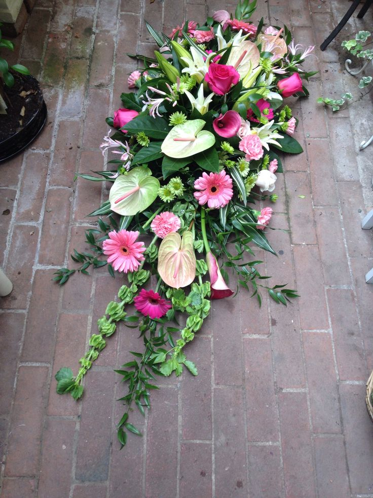 A funeral tribute with pink floyd roses, anthurium, gerberas and molucella