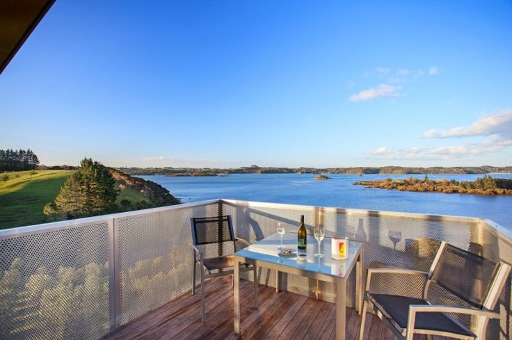 Architecture, Metal Balustrade Stainless Steel Chairs Stainless Table Wooden Flooring In Outside Room With Ocean Views Wine Glass Bottle Exterior Waterfront House From New Zealand: Awesome Modern Waterfront House From New Zealand