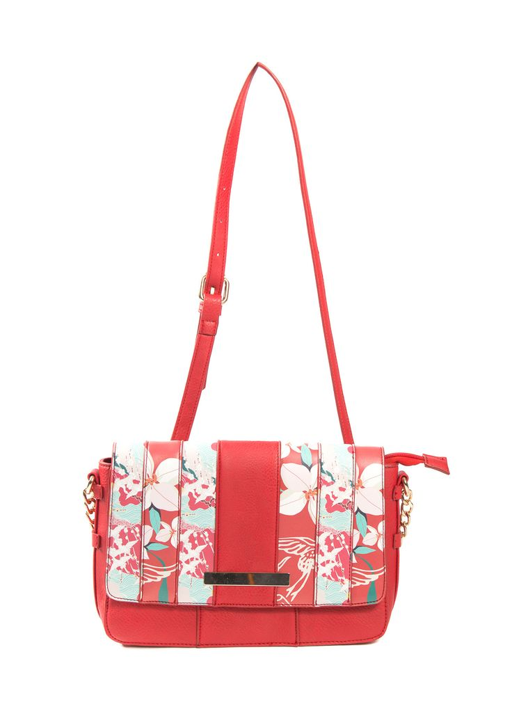 Crossbody bag with floral print on the front flap and inside pockets.