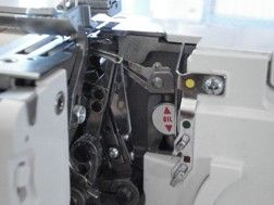 UPPER LOOPER POSITION Depending on the program, the looper will automatically be in the engaged or disengaged position. This makes it possible to offer you a machine that both overlocks and sews more like a traditional sewing machine with the chainstitch and cover hems. #elna #overlock #elna845