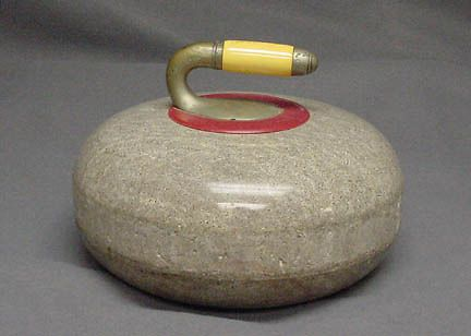 """This curling stone belonged to 75-year-old curler Rudy Senich, of Duluth, Minn., and was used in the Winter Olympics in Nagano, Japan in 1998. According to Senich's curling club rulebook, """"Curling is a game of skill and traditions . . . Curlers play to win, but never to humble their opponents. A true curler would prefer to lose, rather than to win unfairly!"""""""