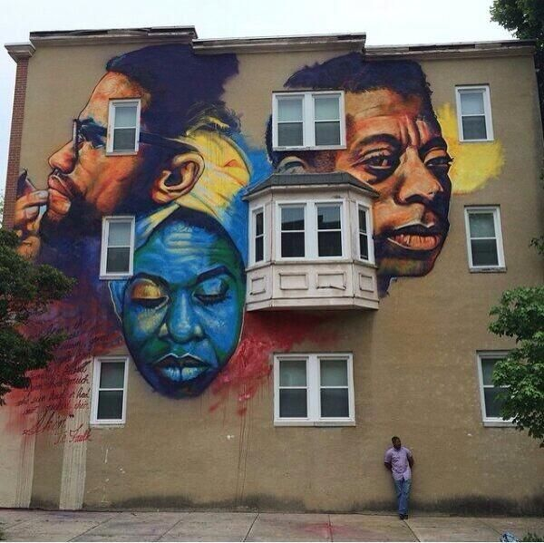 Artist Ernest Shaw Street Art mural in East Baltimore, USA of Malcolm X, Nina Simone & James Baldwin