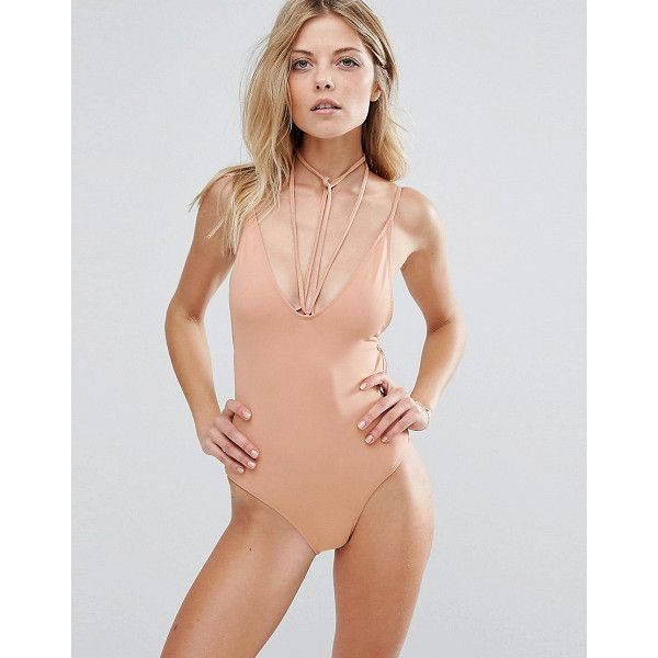 The latest women's sexy beachwear in neutral shades of beige, pink and brown. Shop our selection from the top fashion stores.